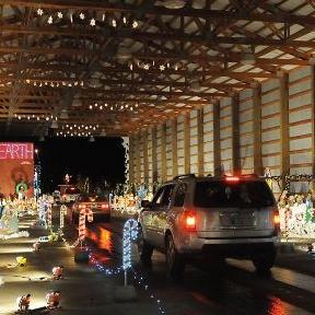 Photo of car driving through the Pastega Christmas Light Display