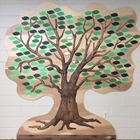 The Foundation Giving Tree is affixed to a wall inside the Auditorium Building. The raised-relief,  wooden tree, is covered in  leaves where bronze-colored, silver-colored and gold-colored leaves commemorating or celebrating people are overlaid.
