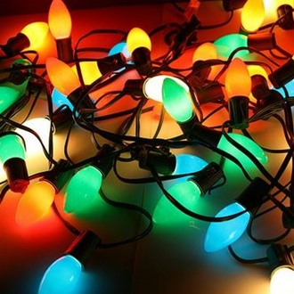 Photograph of colored light strands in a tangled heap