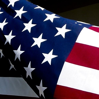 Photograph of USA flag focusing on a close-up of stars and stripes