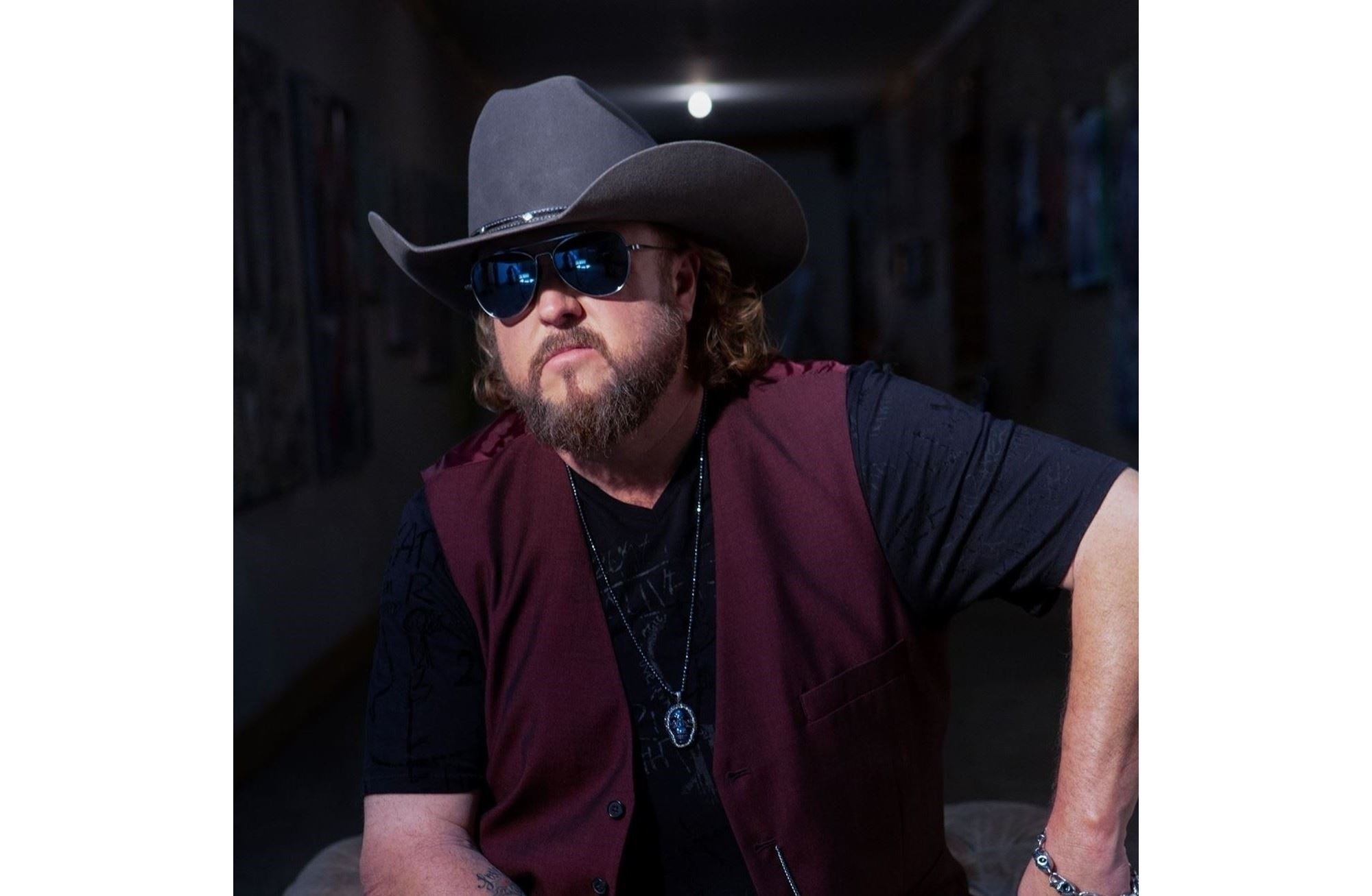 Photo: Colt Ford wearing cowboy hat and sunglasses