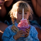 Photo: Young girl holding a huge cup of shaved ice