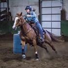 Photo: 4-H barrel racer on her horse racing the clock