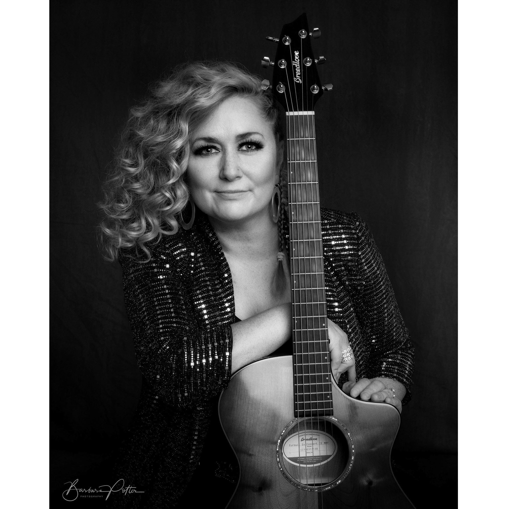 Photo: Jessica Lynne with her guitar