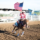 Rodeo Queen parading in the USA flag at opening ceremony