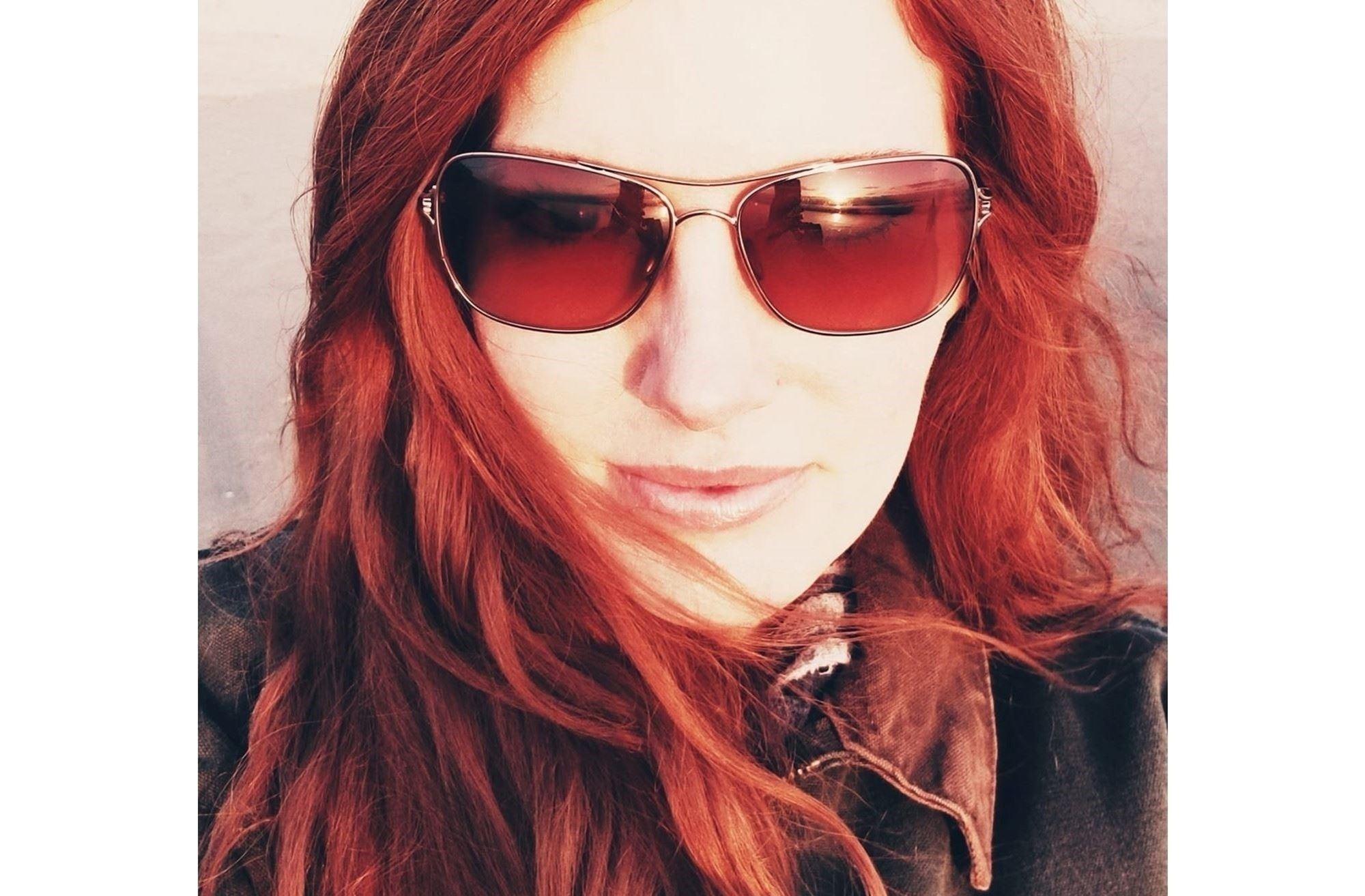 Photo: Catherine Loyer headshot wearing sunglasses