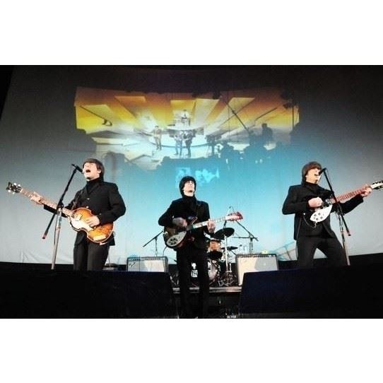 Photo: band members of Yesterday: Beatles Tribute band