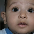 Wide eyed toddler looking up