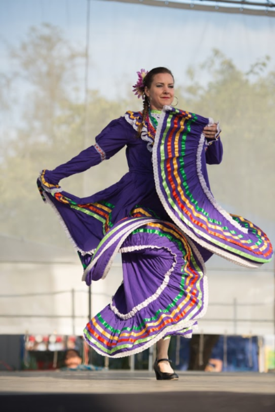 Woman in Mexican dancer costume