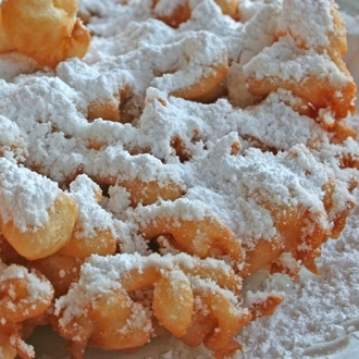 Funnel Cake covered in powdered sugar