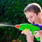 Young boy squirting a water gun