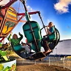 Photo: Children riding on carnival ride
