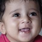 Smiling toddler looking up