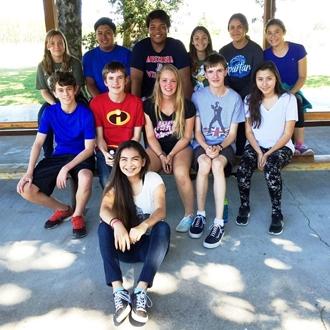 2016 Teen Hosts group shot at picnic table
