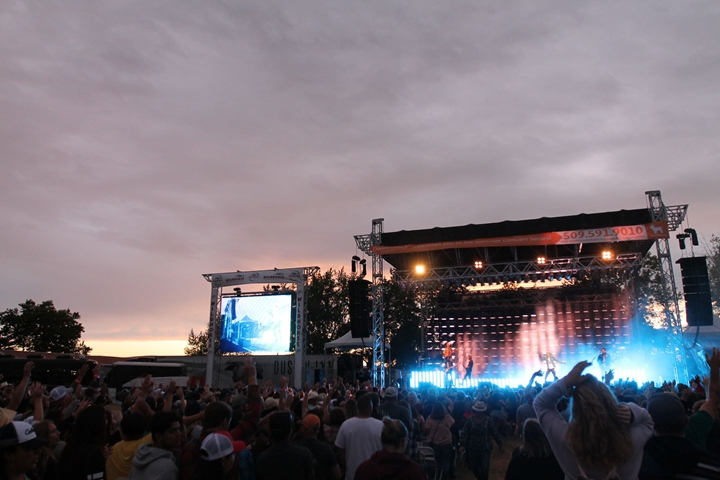 Concert photo of stage and crowd at dusk
