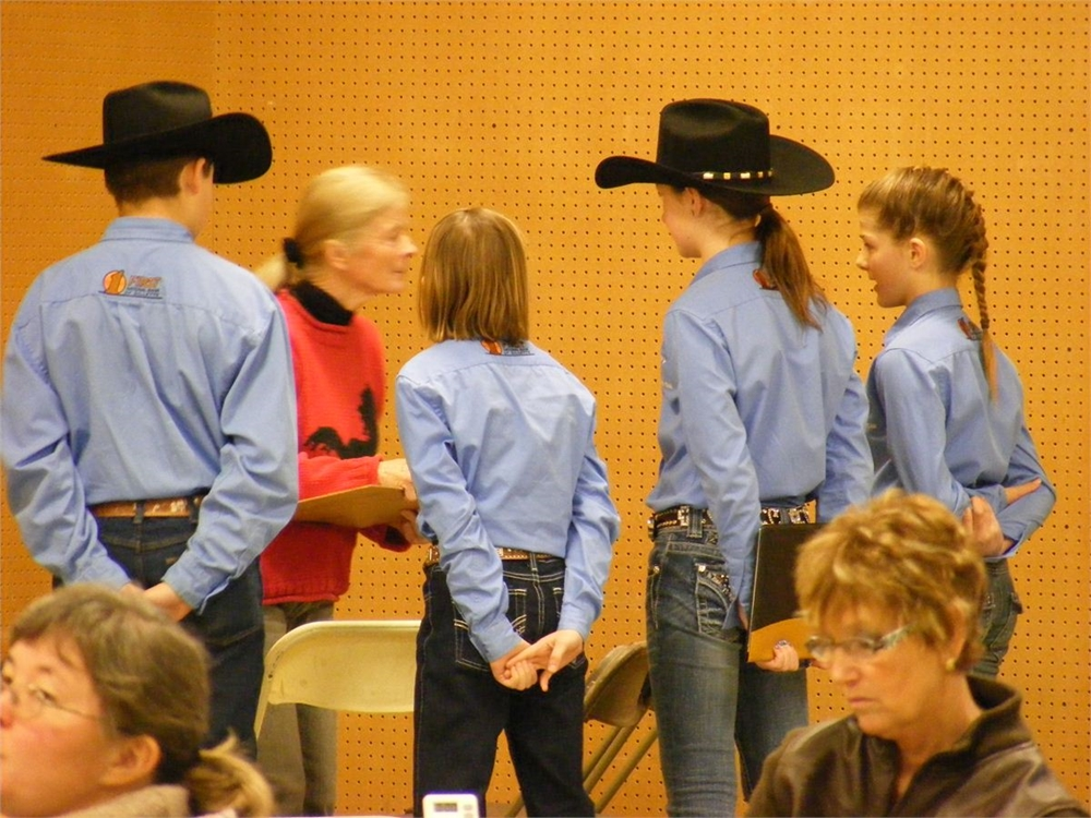 Campbell Co. team from Wyoming giving their oral part of the Jr. Hippology team problem