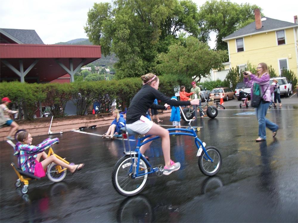 Girl riding an unusual bike in the rain