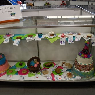 Bake Shop display case with a decorated cake
