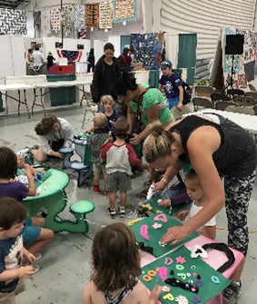 Adults and kids working on craft activities
