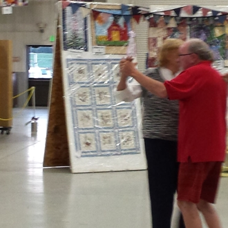 A couple dancing to music during Senior Day