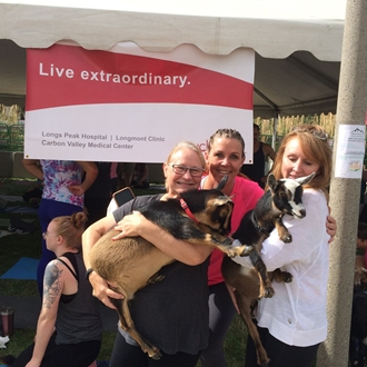 Sponsor UCHealth Longs Peak Hospital having fun at Goat Yoga