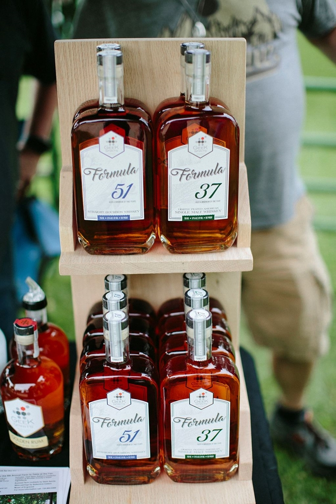 Distillery 51 and 37 display on a shelf at the Craft Distillery Festival