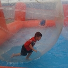 Small boy in a bubble ball in a pool
