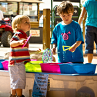 Two kids having fun playing with bubbles in Kid's Corral