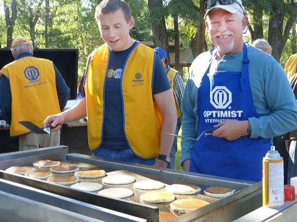 Optimist Club members serving breakfast