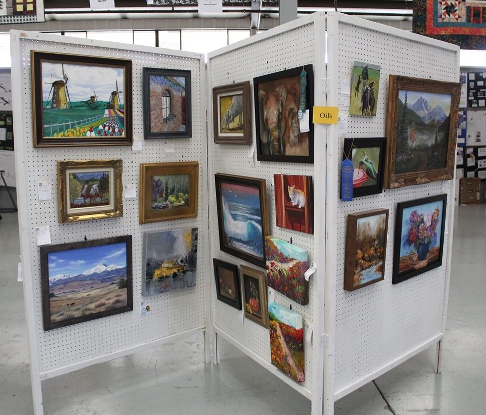 Painting and Sculpture entries displayed on pegboard