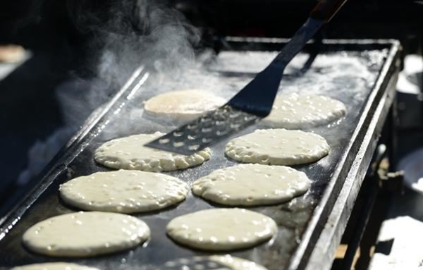 Pancakes on the griddle at the Optimist Club Pancake Breakfast