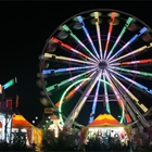 A brightly lit Ferris Wheel in the evening