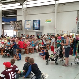 Crowd in Exhibit Building watching 4-H Fashion Review