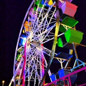 Brightly colored Ferris Wheel at night
