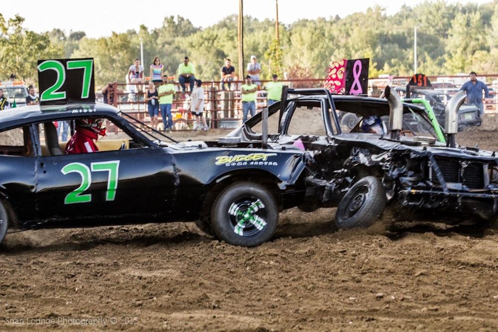 Black Demo Derby car number 27  crashed in to car 8