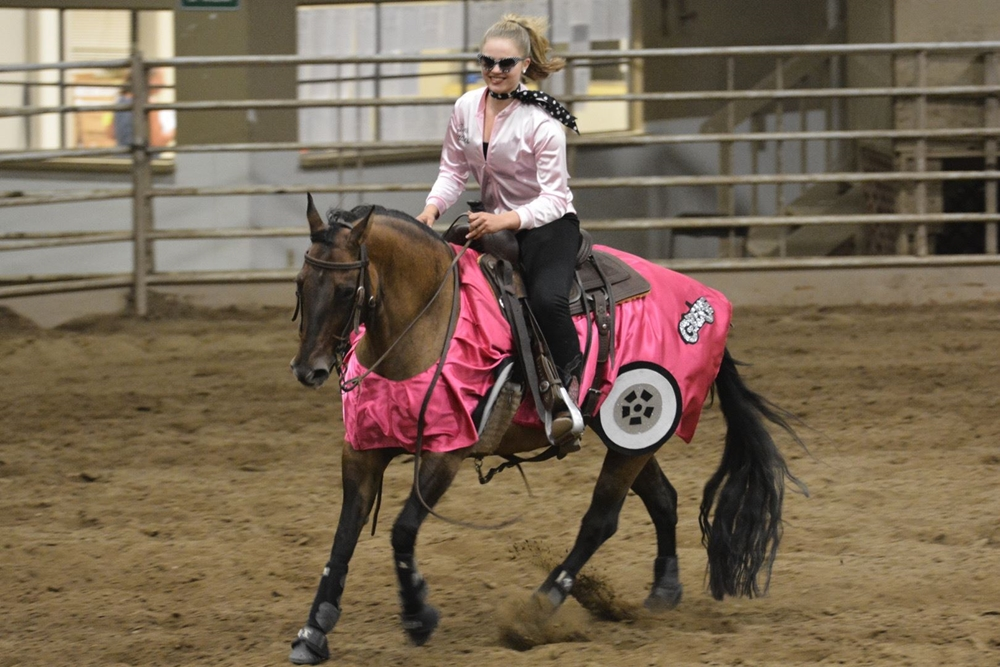 Youth dressed in a costume in  Freestyle Reining class