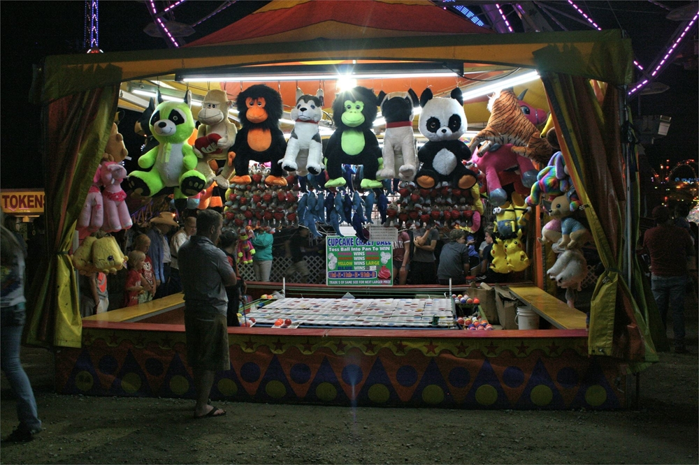 Carnival game with balloons and stuffed animals