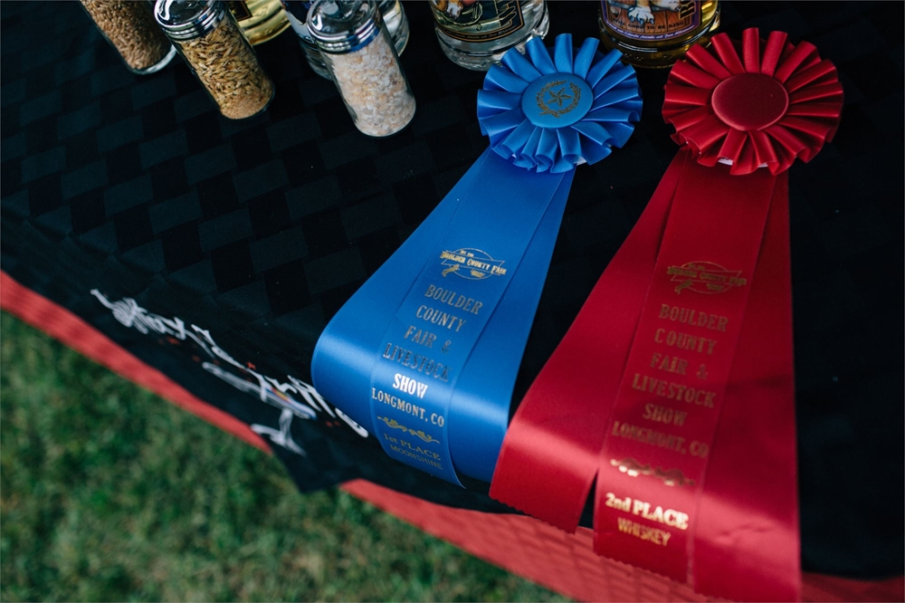 Two ribbons 1 blue first and a second place ribbons at the Craft Distillery Festival
