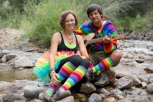 Jeff & Paige Band dressed as clowns in a mountain stream