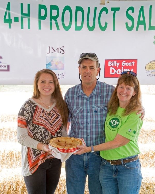 A girl holding her double custed pie  at the 4-H Product Sale
