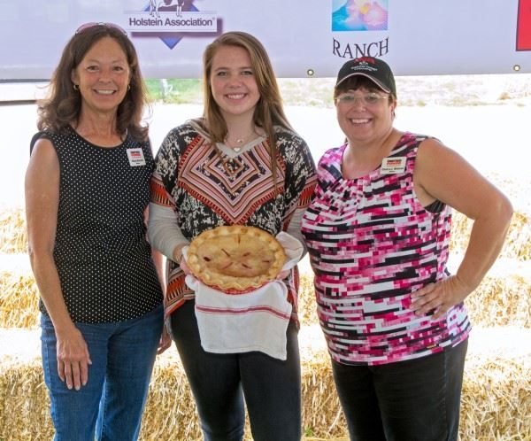 Girl displaying her double crust pie for the 4-H Product Sale