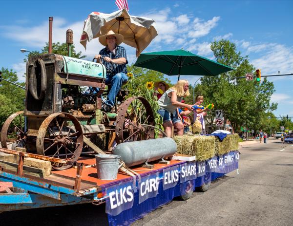 Parade exhibit of old tractor Elks Club