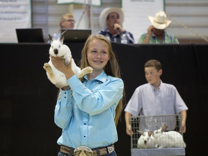 2 4-H youths with their rabbits at the rabbit show