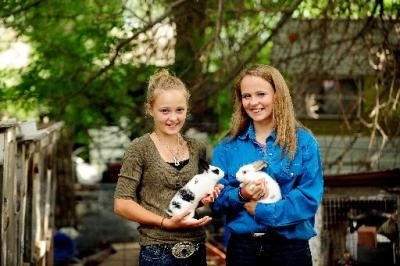 Two 4-H girls holding rabbits