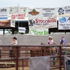 Cowboys and cowgirls practicing in warm up arena during the CPRA Rodeo