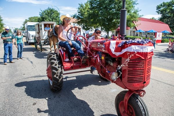 Woman driving an antique tractor in the Fair parade