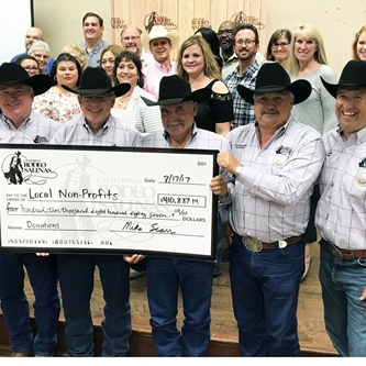 CALIFORNIA RODEO SALINAS PRESENTS LOCAL NON-PROFITS WITH CHECKS