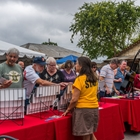 A crowd looks at merchandise at the songwriters festival.