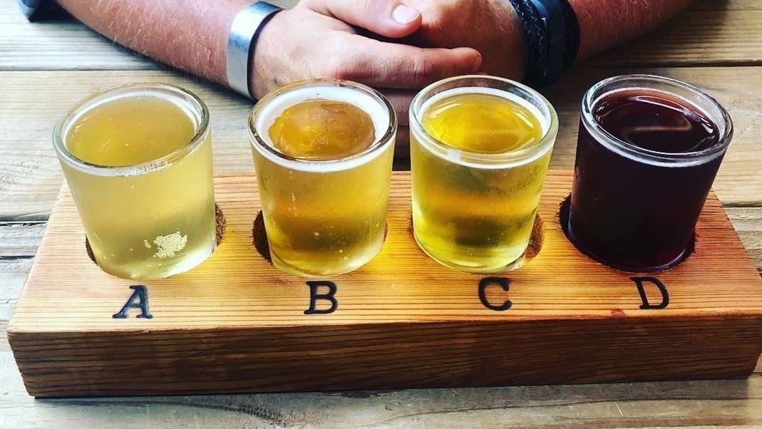 a tasting flight of 4 ciders
