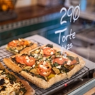 A vegetable tart cooling on a rack at a restaurant